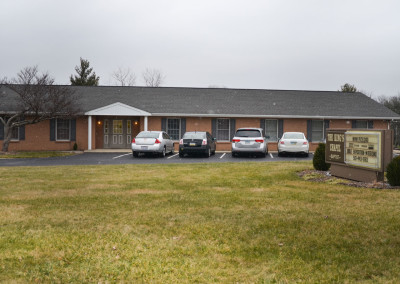 Front of church building showing parking